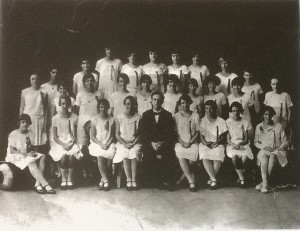 1926 Townsville State High School Choir - Mr V. Foley, Conductor Back Row L-R: Enid Kutzman, Mary King, Marge Vanderburg, Alice Fry, Gertie Bayant, Marge Schmidt, Gwen Gregory, Dulcie Barton. Middle Row L-R: Ruth Hunter, Lolla Launder, May West, Alice Ross, ? , May Baker, Mary McLaughlan, Ann Morris, Lottie Nee, Nina Rankin, Aggie Edwards. Front Row L-R: Aubie Hooper, Pattie Lovell, ? , Gwen Peake, Mr Foley, Edna Bragg, Edna Woods, Phyllis Porter, Alice Wilson. (from the collection of Mr John Mathew)